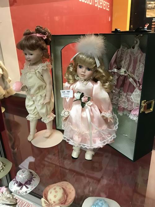 LOT 141	~	2 x Porcelain Dolls w Wardrobe Case