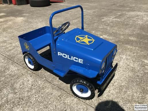 LOT 121	~	Police Pedal Car - New
