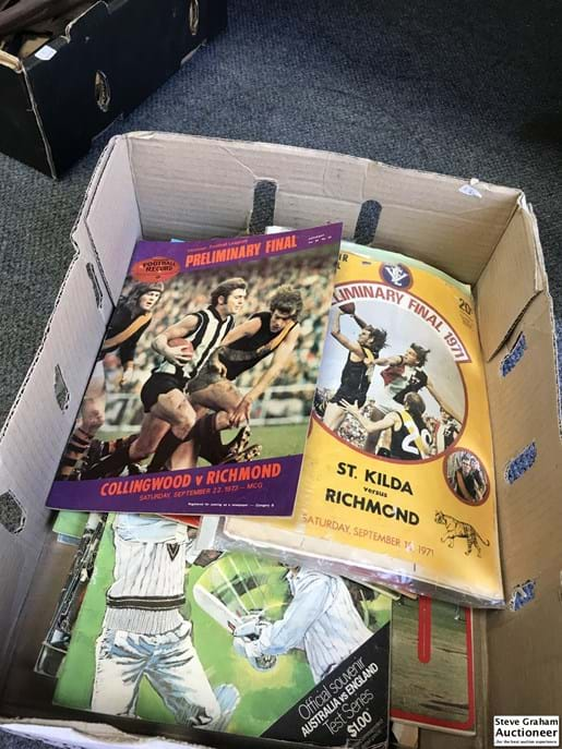 LOT 143	~	Box of  VFL Finals Footy Records & Cricket Books