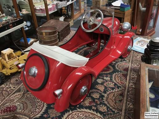 LOT 169	~	Red Reproduction Pedal Car