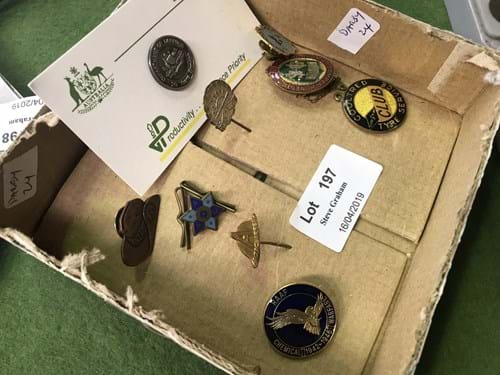 LOT 197	~	Box of Badges, Pins etc