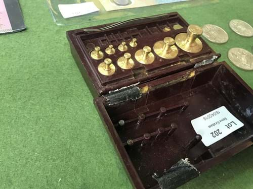LOT 202	~	Set of Apothecary Weights
