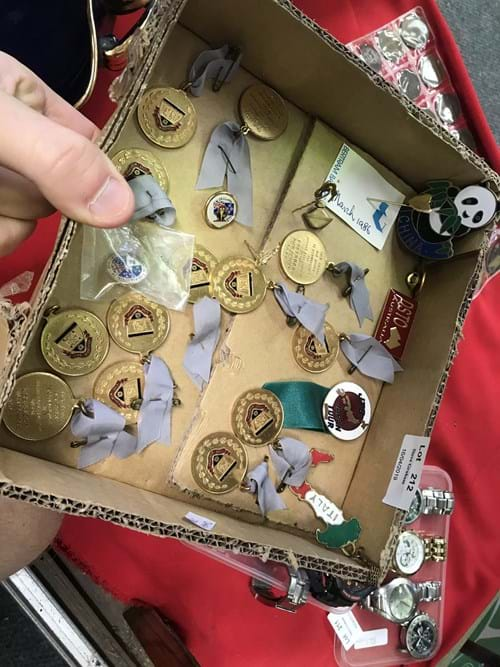 LOT 212	~	Box of Badges, Pins etc