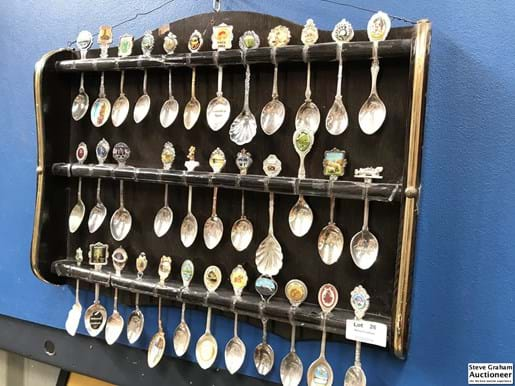 LOT 26	~	Collectors Spoons in Wall Mounted Display Rack