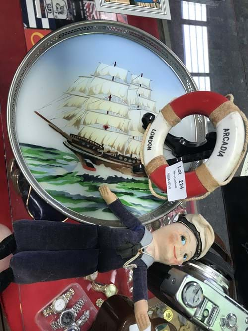 LOT 224	~	Oriana Sailor Doll, Arcadia Souvenir Life Buoy & Drinks Tray