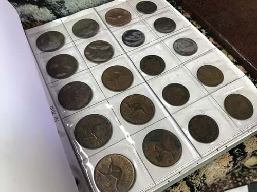 LOT 253	~	Folder of Assorted Coins