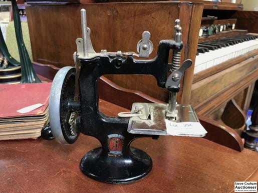 LOT 296	~	Peter Pan Childs Sewing Machine with Table Clamps & Instructions