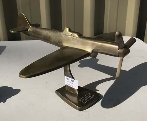 LOT 262	~	brass trench art style plane