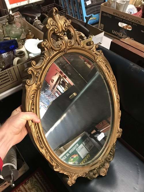 LOT 34	~	Ornate Oval Framed Mirror