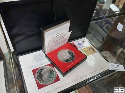 LOT 36	~	1975 Papua New Guinea 10 Kina Silver Proof Coin (.925  41.6 gram) & 1977 Queen Elizabeth 10 Kina Coin & Stamp Set