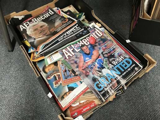 LOT 7	~	Box of AFL Footy Records, Newspapers, Ephemera