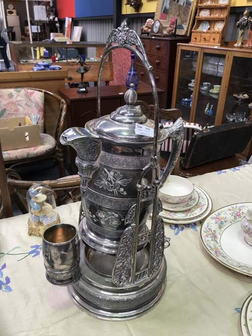 LOT 232	~	1800's Simpson, Hall, Miller & Co Tilting Silver Plated Pitcher on Stand with Cup